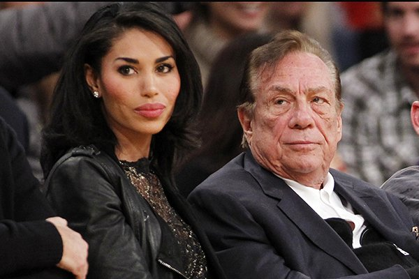 in-this-dec-19-2010-file-photo-los-angeles-clippers-owner-donald-sterling-right-and-v-stiviano-left-watch-the-clippers-play-the-los-angeles-lakers-during-an-nba-preseason-basketball-game-in-los-angeles-nba-commissioner-adam-silver-is-intent-on-moving-quickly-in-dealing-with-the-racially-charged-scandal-surrounding-clippers-owner-sterling-the-nba-league-will-discuss-its-investigation-tuesday-april-29-2014-before-the-clippers-play-golden-state-in-game-5-of-their-playoff-series-ap-photodanny-moloshok-file