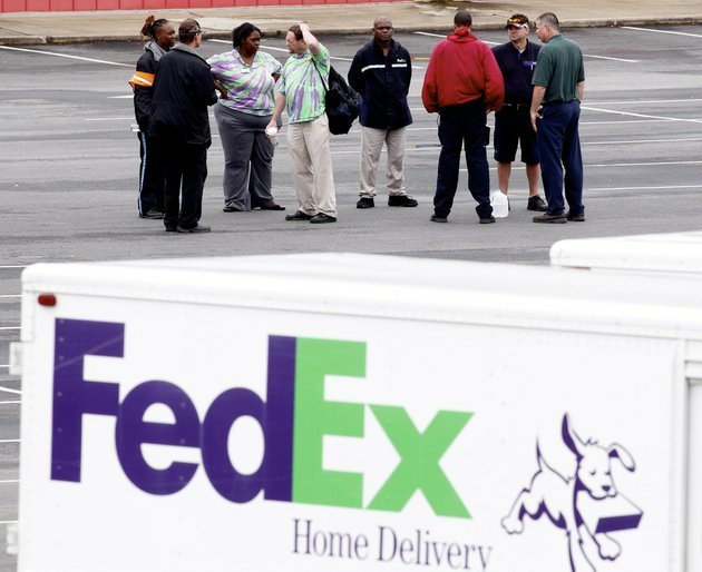 fed-ex-employees-and-friends-wait-at-a-staging-area-at-a-skating-rink-after-a-shooting-at-a-fedex-corp-facility-at-an-airport-in-kennesaw-ga-on-april-29-2014-at-least-six-people-were-reported-hospitalized-from-wounds-according-to-local-reports