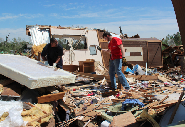 james-guiden-left-works-with-a-volunteer-to-salvage-items-from-his-mayflower-home-which-was-destroyed-in-a-tornado-sunday-night