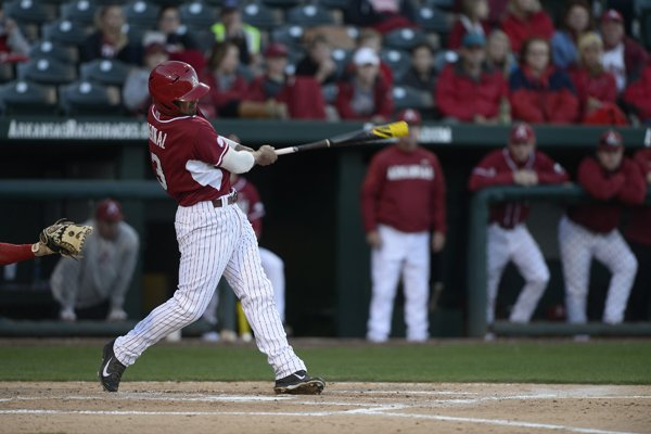 Arkansas' Michael Bernal swings through after connecting on a three run home run against UNLV Tuesday, April 8, 2014, at Baum Stadium in Fayetteville.