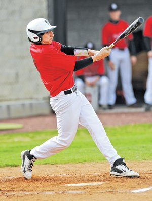 STAFF PHOTO ANDY SHUPE Logan Wichert, Pea Ridge first baseman, connects for an RBI single during the first inning against Farmington on April at Farmington High.