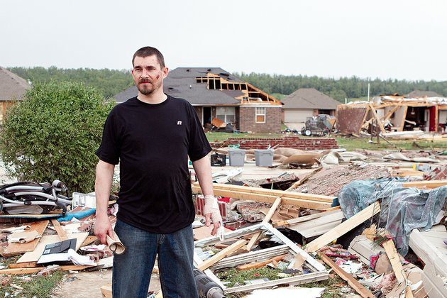 shawn-riddle-39-stands-where-his-home-used-to-be-in-the-parkwood-meadows-subdivision-which-was-heavily-damaged-by-the-tornado-that-hit-vilonia-just-before-8-pm-sunday-riddles-wife-melissa-and-their-three-children-were-injured-shawn-said-tuesday-that-melissa-remained-hospitalized-with-a-broken-pelvis-and-other-injuries-he-suffered-a-broken-finger-cuts-and-bruises-in-the-storm-which-had-winds-of-at-least-135-mph-according-to-the-national-weather-service