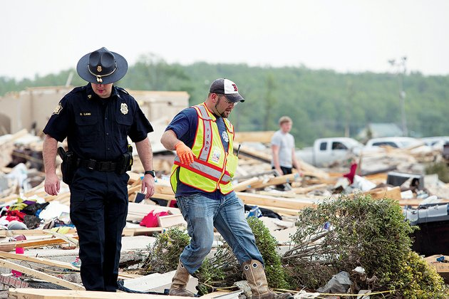 law-enforcement-officers-and-volunteers-such-as-these-in-vilonia-looked-through-the-rubble-after-sunday-nights-tornado-that-killed-eight-people-and-hospitalized-at-least-nine-others-in-the-community-one-of-whom-was-in-critical-condition-at-press-time