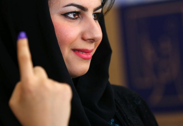 an-iraqi-kurdish-woman-shows-her-ink-stained-finger-after-casting-her-vote-at-a-polling-station-in-irbil-north-of-baghdad-iraq-on-wednesday-april-30-2014-iraq-is-holding-its-third-parliamentary-elections-since-the-us-led-invasion-that-toppled-dictator-saddam-hussein