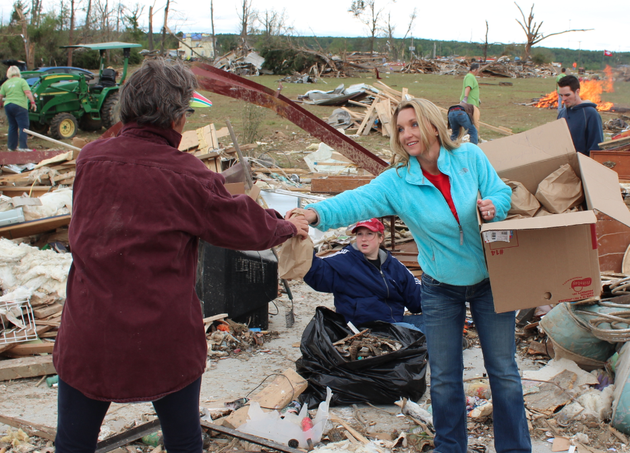 maree-coats-right-hands-out-lunch-at-a-destroyed-home-along-cemetery-road-wednesday-in-vilonia