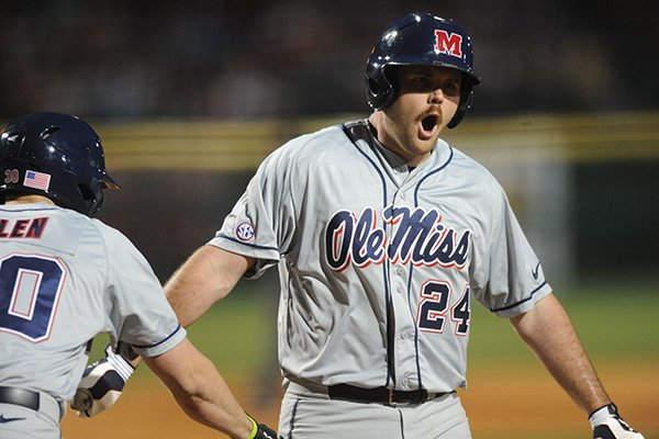 Ole Miss first baseman Sikes Orvis (24) celebrates a solo home run off Arkansas starter Trey Killian Friday, March 15, 2013, during the fourth inning of play at Baum Stadium in Fayetteville.