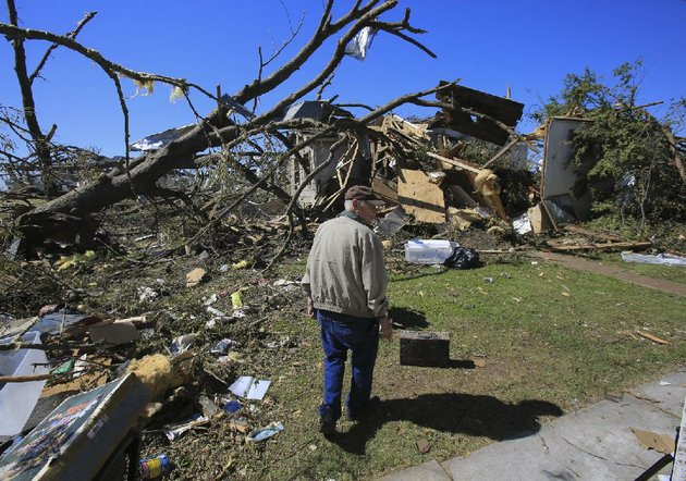 arkansas-democrat-gazettestaton-breidenthal-5114-bill-ausbrooks-walks-through-the-back-yard-of-his-tornado-damaged-house-at-681-highway-365-in-mayflower-thursday-as-his-family-helps-salvage-items-from-the-home-ausbrooks-built-the-house-in-1956