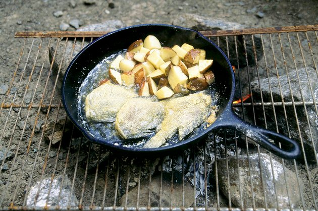 a-few-potatoes-and-onions-can-be-cooked-right-in-the-skillet-with-fish-for-a-delicious-meal-outdoors