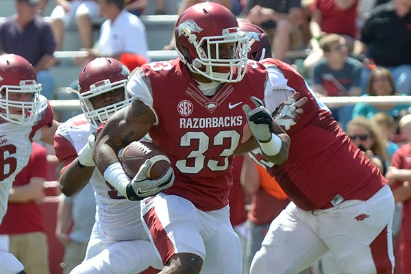 Arkansas running back Korliss Marshall runs the ball for a touchdown during the Red-White game Saturday afternoon at Razorback Stadium in Fayetteville.