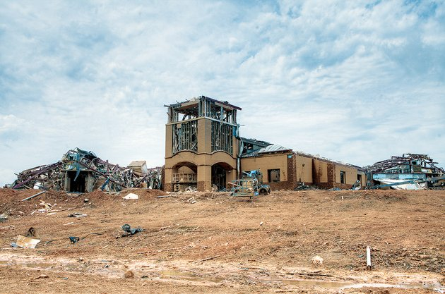 the-13-million-vilonia-intermediate-school-on-mount-olive-road-scheduled-to-be-completed-in-july-was-destroyed-by-the-april-27-tornado-the-district-had-reconfigured-grades-to-put-four-five-and-six-at-the-new-school-superintendent-frank-mitchell-said-furniture-for-the-new-school-had-been-ordered-staff-hired-and-bus-routes-planned-demolition-of-the-school-was-to-begin-soon-mitchell-said
