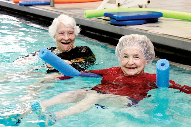 jane-hogan-right-89-and-lillian-mciver-96-participate-in-water-aerobics-with-searcy-splash