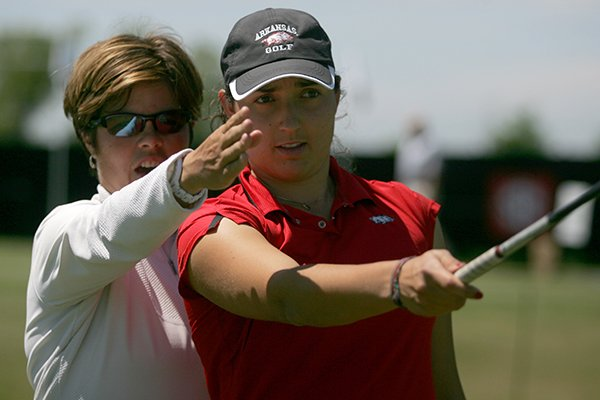Arkansas women's golf head coach Shauna Estes-Taylor, left, and Emily Tubert talk during an afternoon practice session Wednesday, April 18, 2012 at Blessings Golf Course in Johnson.