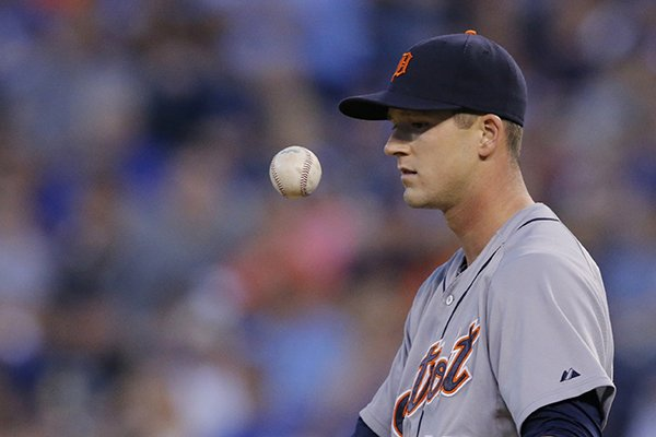 Detroit Tigers starting pitcher Drew Smyly tosses the ball to himself between batters during the seventh inning of a baseball game against the Kansas City Royals in Kansas City, Mo., Saturday, May 3, 2014. (AP Photo/Orlin Wagner)