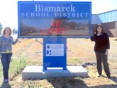 Submitted photo Bismarck Parent Teacher Organization President Dawn Sampson, left, and Susan Wade, manager of the Southern Bancorp, Bismarck branch, display the Bismarck School District's new digital marquee. The PTO donated 80 percent of the funds, raised through various fundraisers, to purchase the marquee. Southern Bancorp, who is a regular supporter of the district, donated the other 20 percent. Doug McDaniel helped install the sign and C.J. Horner donated a portion of the concrete services.