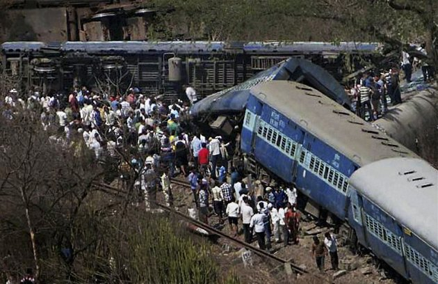 people-gather-around-a-passenger-train-that-derailed-near-roha-station-70-miles-south-of-mumbai-maharashtra-state-india-sunday-may-4-2014-the-cause-of-the-accident-was-not-immediately-known