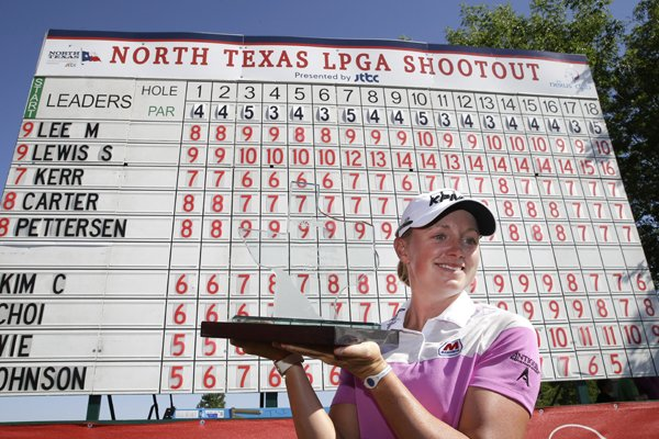 Stacy Lewis posses for a photo with the tourney trophy after winning the North Texas LPGA Shootout golf tournament at the Las Colinas Country Club in Irving, Texas, Sunday, May 4, 2014. (AP Photo/LM Otero)