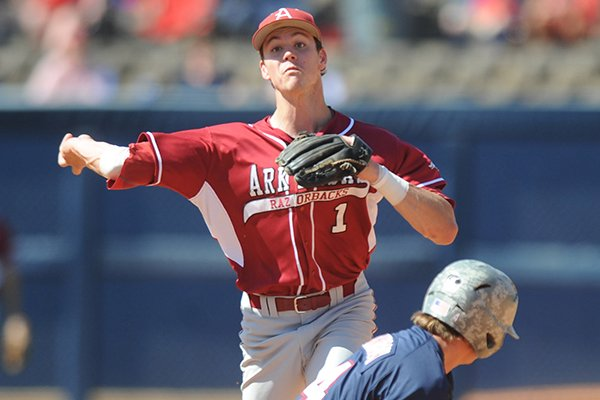 Arkansas second baseman Brian Anderson (1) forces out Mississippi's Will Jamison (4) and throws to first for a double play at Oxford-University Stadium in Oxford, Miss. on Sunday, May 4, 2014. Arkansas won 11-1. (AP Photo/Oxford Eagle, Bruce Newman)