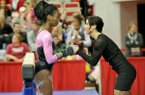 Arkansas gymnastics co-head coach Rene Lyst talks with gymnast Keara Glover before she competes on the beam during a meet against Florida on Friday, Feb. 1, 2013 at Barnhill Arena in Fayetteville.