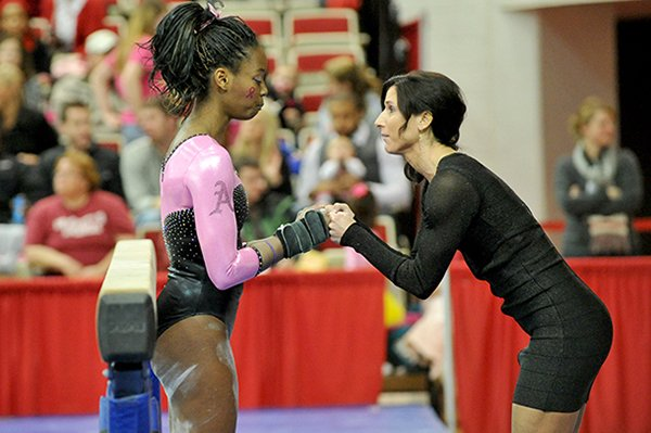 972232346be54 Arkansas gymnastics co-head coach Rene Lyst talks with gymnast Keara Glover  before she competes