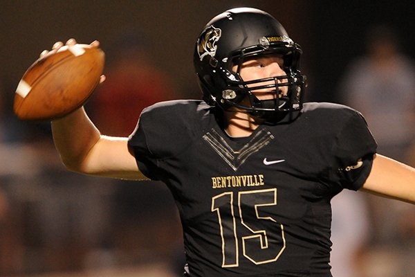 Bentonville quarterback Kasey Ford throws a pass during the first half of the game against Springdale Har-Ber in Tiger Stadium on Friday Sept. 27, 2013.