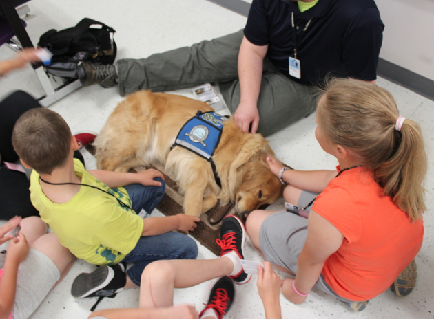 students-at-mayflower-elementary-school-pet-a-comfort-dog-monday-in-the-first-day-back-at-school-more-than-a-week-after-a-tornado-devastated-the-faulkner-county-city