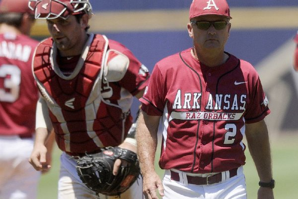 NWA Media/MICHAEL WOODS  --05/25/2013--  University of Arkansas coach Dave Van horn heads bach to the bench after talking with the team in the 4th inning of Saturdays game against the Tigers in the 2013 SEC baseball tournament in Hoover, Alabama.
