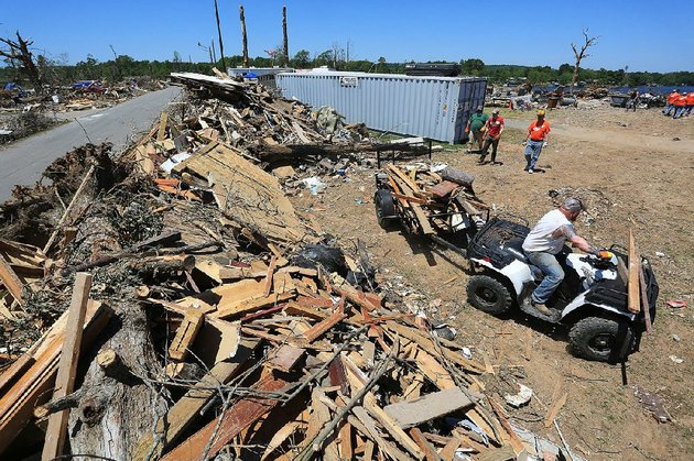 arkansas-democrat-gazetterick-mcfarland-050514-robert-steinle-cq-of-sherwood-pulls-a-load-of-debris-with-a-4-wheeler-to-be-unloaded-aside-dam-rd-in-mayflower-monday-an-f-4-tornado-hit-the-area-april-27