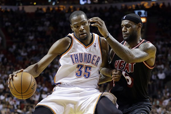in-this-jan-29-2014-file-photo-miami-heat-small-forward-lebron-james-6-puts-pressure-on-oklahoma-city-thunder-small-forward-kevin-durant-35-during-the-fourth-period-of-an-nba-basketball-game-in-miami-james-says-durant-would-be-a-deserving-winner-of-the-nba-mvp-award-its-expected-that-durant-will-be-announced-as-this-seasons-mvp-later-this-week-ap-photo-alan-diaz-file