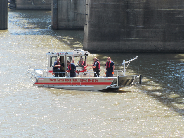 a-north-little-rock-fire-department-rescue-team-searches-the-arkansas-river-between-the-downtown-areas-of-little-rock-and-north-little-rock-on-tuesday-after-a-witness-reported-seeing-a-person-jump-from-the-junction-bridge