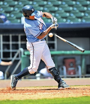 STAFF PHOTO SAMANTHA BAKER • @NWASAMANTHA Jorge Bonifacio of the Northwest Arkansas Naturals snaps his bat in half Tuesday at Arvest Ballpark in Springdale during the game against the visiting Arkansas Travelers.