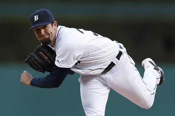Detroit Tigers pitcher Robbie Ray throws a warm up pitch against the Houston Astros in the third inning of a baseball game in Detroit Tuesday, May 6, 2014. (AP Photo/Paul Sancya)
