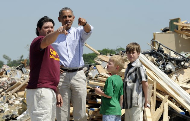 president-barack-obama-tours-tornado-damaged-areas-of-vilonia-ark-wednesday-may-7-2014-and-talks-with-daniel-smith-and-his-sons-garrison-dority-and-gabriel-dority-right-obama-is-visiting-with-first-responders-and-families-affected-by-the-recent-tornados-before-traveling-on-to-california-where-he-will-raise-money-for-the-democratic-party-and-receive-an-award-from-a-foundation-created-by-movie-director-steven-spielberg