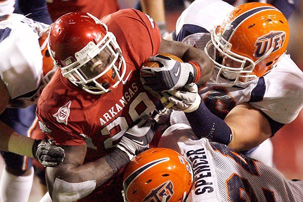 Arkansas running back Broderick Green is pulled down by UTEP defenders on a carry during the fourth quarter on Saturday, Nov. 13, 2010, at Donald W. Reynolds Razorback Stadium in Fayetteville.