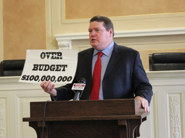 sen-bryan-king-r-green-forest-holds-up-a-sign-critical-of-the-costs-of-the-states-private-option-medicaid-expansion-while-speaking-at-a-news-conference-thursday