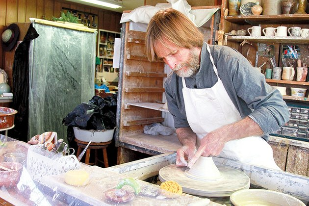 john-perry-works-on-a-piece-of-pottery-in-his-studio-at-the-ozark-folk-center-in-mountain-view