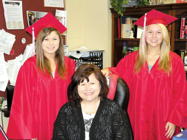 cave-city-high-school-counselor-vickie-green-poses-with-her-twin-daughters-allison-left-and-ashley-the-twins-whose-father-steven-is-superintendent-of-the-cave-city-school-district-are-two-of-the-six-valedictorians-at-cave-city-high-school