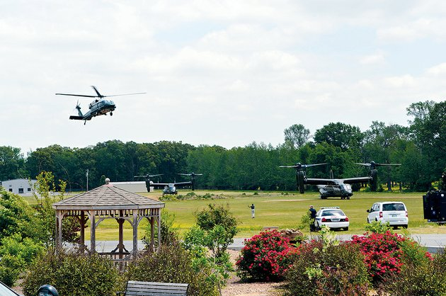 a-helicopter-lands-at-the-vilonia-middle-school-field-wednesday-one-of-four-helicopters-including-two-osprey-pictured-that-arrived-president-barack-obama-was-in-an-identical-marine-one-chopper-which-landed-last