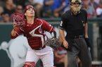 Arkansas catcher Alex Gosser tracks a fly ball against Texas A&M during the second inning Friday, May 9, 2014, at Baum Stadium in Fayetteville.