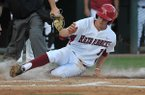 Arkansas' Brian Anderson slides into home plate during the second inning of a game against Texas A&M on Saturday, May 10, 2014 at Baum Stadium in Fayetteville. Arkansas won 7-3.