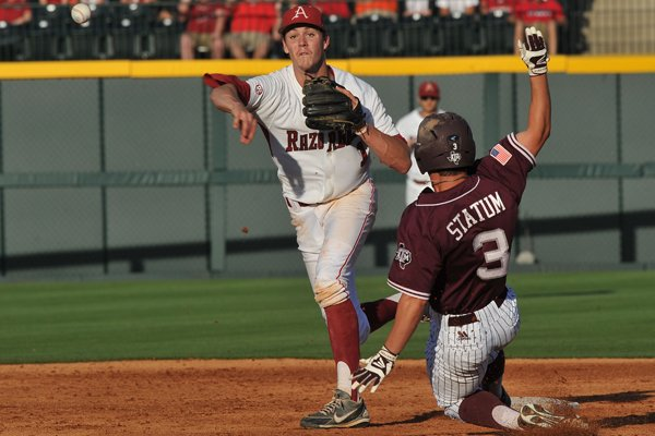 Arkansas second baseman Brian Anderson forces A&M baserunner Jace Statum out at second base as he turns a double play in the 3rd inning of the May 10, 2014, game against Texas A&M at Baum Stadium.