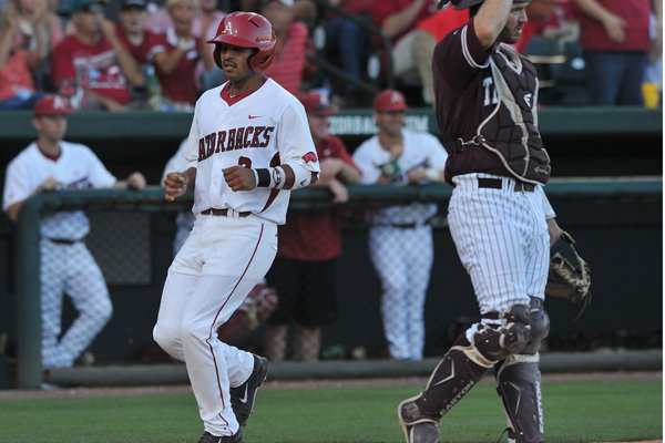 Arkansas baserunner Michael Bernal scores a run in the 3rd inning of the May 10, 2014, game against Texas A&M at Baum Stadium.