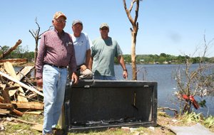 Louie Short (left) was huddled next to his large gun safe when his Mayflower home was struck by the April 27 tornado. The safe, which weighed more than 800 pounds, was ripped from the concrete slab and flung 80 yards into Lake Conway. Short's sons, professional bass angler Kevin Short (center) and Conway detective David Short, helped recover it.