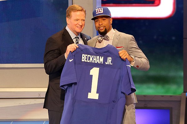 Odell Beckham Jr. is seen with NFL Commissioner Roger Goodell after being selected by the New York Giants at the 2014 NFL Draft at Radio City on Thursday, May 8th, 2014 in New York, NY. (AP Photo/Gregory Payan)