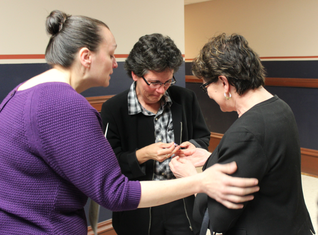 lisa-weber-center-and-terri-langley-weber-right-exchange-rings-during-a-wedding-ceremony-tuesday-at-the-pulaski-county-courthouse-officiated-by-julie-gerlinger