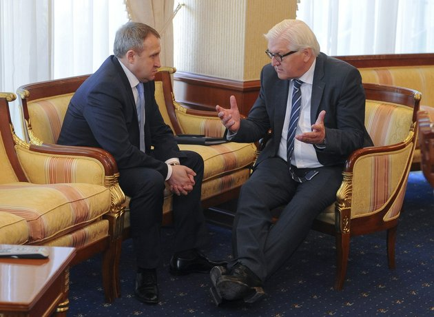german-foreign-minister-frank-walter-steinmeier-right-talks-with-his-ukrainian-counterpart-andrii-deshchytsia-during-his-visit-to-kiev-ukraine-on-tuesday-may-13-2014-steinmeier-flew-to-ukraine-on-tuesday-to-help-start-talks-between-the-ukrainian-government-and-its-foes-after-the-declaration-of-independence-by-two-eastern-region