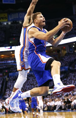 Los Angeles Clippers forward Blake Griffin (right) is fouled by Oklahoma City's Russell Westbrook in the first quarter of the Thunder's 105-104 victory in the NBA Western Conference semifinals. Griffin led the Clippers with 24 points and 17 rebounds.