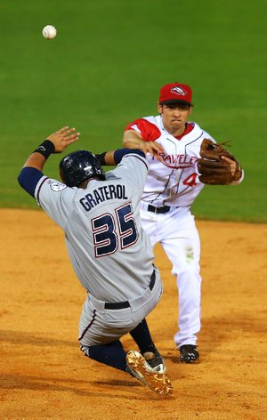 Arkansas shortstop Vance Albitz forces Northwest Arkansa' Juan Graterol at second base in the fourth inning of the Travelers 4-3 victory Tuesday at Dickey-Stephens Park in North Little Rock.