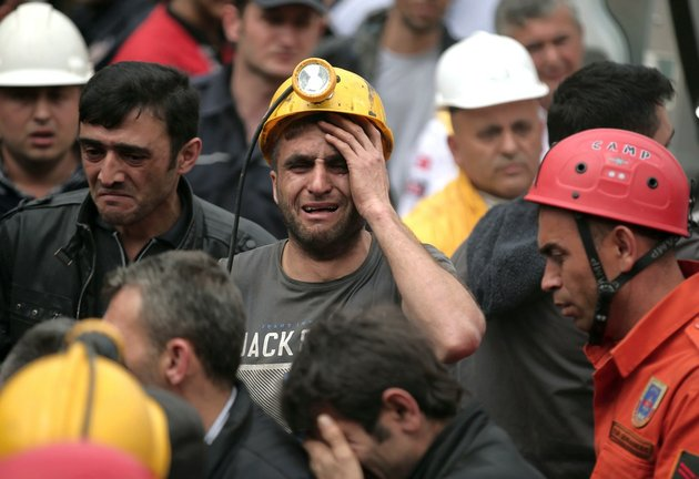 a-miner-cries-as-rescue-workers-carry-the-dead-body-of-a-miner-from-the-mine-in-soma-western-turkey-on-wednesday-may-14-2014-an-explosion-and-fire-at-the-coal-mine-killed-at-least-232-workers-authorities-said-in-one-of-the-worst-mining-disasters-in-turkish-history-turkeys-energy-minister-taner-yildiz-said-787-people-were-inside-the-coal-mine-at-the-time-of-the-accident