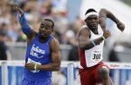 Indiana State's Greggmar Swift, left, collides with Arkansas' Omar McCleod at the finish line of the university men's 110-meter hurdles during the Drake Relays athletics meet, Saturday, April 26, 2014, in Des Moines, Iowa. Swift finished in second place and McLeod third. (AP Photo/Charlie Neibergall)