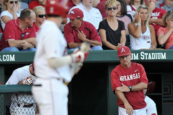 Arkansas coach Dave Van Horn sends in a signal to a hitter during a game against Texas A&M on Saturday, May 10, 2014 at Baum Stadium in Fayetteville.